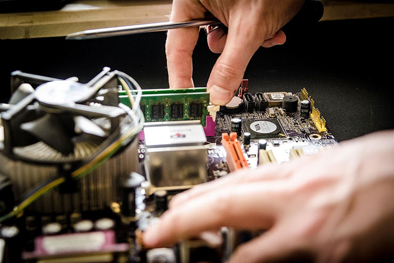 Person checking the components of a mainboard