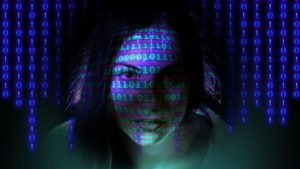 Woman's face with binary code overlaid
