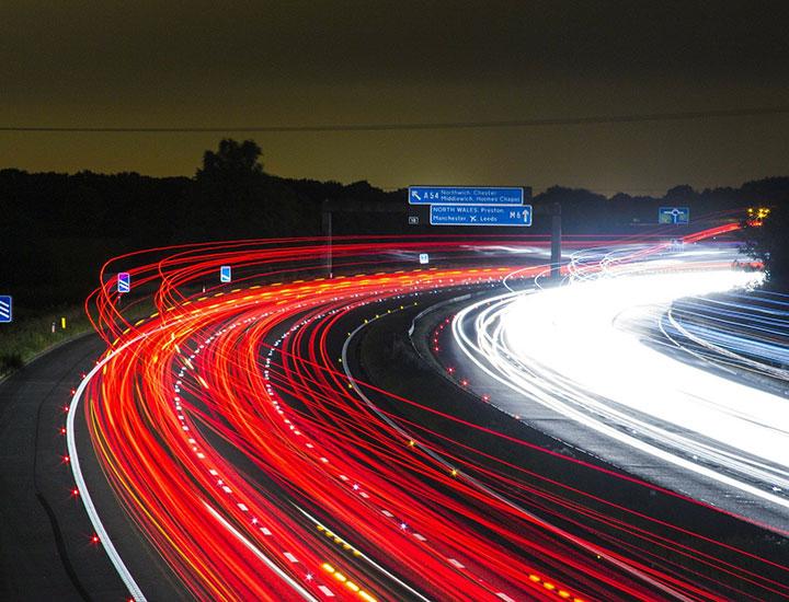 Motorway showing speeding light lines