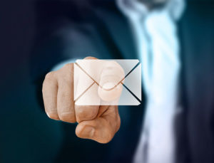Businessman finger pointing to email icon
