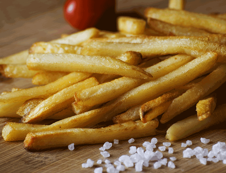 Some chips on a wooden board